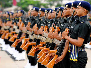 In pic:New recruits of The Indian Army Services Corps take part in a passing out ceremony in Bangalore on June 17, 2015.
