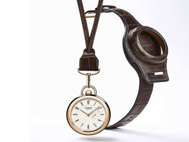 The rose gold case of the new In The Pocket watch contains a silver dial with baton-type hands that sweep over pared-down numerals.