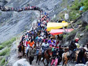 In pic: Piligrims proceed towards Amarnath Holy Cave Shrine in south Kashmir on Thursday 2 July 2015.