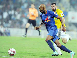 In this file photo Mumbai City FC footballer Nicolas Anelka (L) dribbles the ball past Colin Falvey of Kerala Blasters FC during the Indian Super League (ISL) football match. Mumbai City FC today named prolific Anelka as their marquee player-cum-manager for the second season of the Indian Super League football tournament.