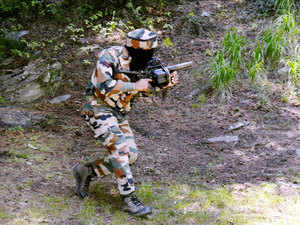 In pic: An army person takes position during an encounter with militants near the Line of Control in Uri sector of north Kashmir on July 4, 2015.