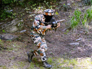 In pic: An army person takes position during an encounter with militants near the Line of Control in Kashmir on July 4, 2015.