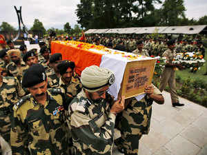In pic: Border Security Force soldiers carry a coffin containing the body of their colleague during a wreath laying ceremony in Humhama, Srinagar, July 10, 2015.