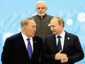Kazakhstan's president NursultanNazarbayev (L) chats with Russianpresident Vladimir Putin, with IndianPM Narendra Modi in the backgroundat the Shanghai CooperationOrganization summit in Ufa.