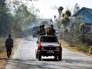 File photo: A vehicle carrying armed security personnel passes along a road on the outskirts of Imphal, Manipur on February 18, 2012.