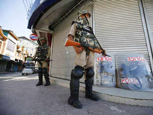 File photo: Indian Central Reserve Police Force (CRPF) personnel stand guard in front of closed shops during a strike in Srinagar June 17, 2015.
