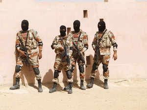 In pic: Pakistan Rangers stand before taking their positions during a counter-terrorism training demonstration on the outskirts of Karachi on June 18, 2015.