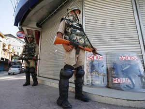 Representational image: Police personnel stand guard in front of closed shops during a strike in Srinagar June 17, 2015.