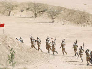 In pic: Pakistan Rangers walk with their weapons during a counter-terrorism training demonstration on the outskirts of Karachi, Pakistan, February 24, 2015.