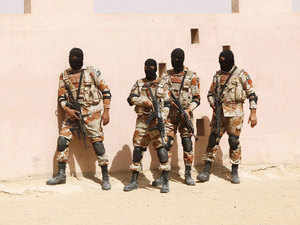 In pic: Pakistan Rangers stand before taking their positions during a counter-terrorism training demonstration at RSSC in Karachi, Pakistan, February 24, 2015.