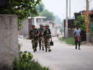 In pic: BSF soldiers patrol at Garkhal village, 30 kilometers (19 miles) from Jammu, India, Wednesday, July 15, 2015.