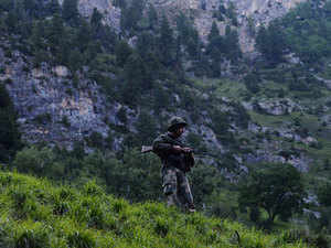 In pic: BSF soldier stands guard in Baltal near Srinagar, Kashmir on July 2, 2015.