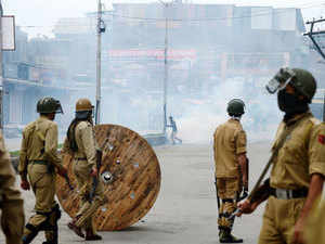 In picture: Protesters clash with police during a protest in Srinagar on July 10, 2015.