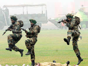 File photo: Indian army soldiers demonstrate combat skills during the Army Day parade in New Delhi on January 15, 2014.