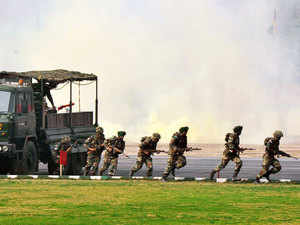 In pic: Soldiers display their combat skills during the Army Day parade in New Delhi on January 1, 2013.