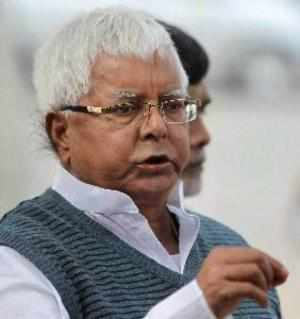 """RJD chief Lalu Prasad hit out at the Prime Minister, calling him """"Kaliya Naag"""", a mythical serpent the Hindu God had slain, and asserting """"we will crush him""""."""
