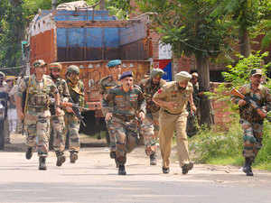 In pic: Army personnel run during an encounter with armed attackers at the police station in Dinanagar town, Gurdaspur district, Punjab on July 27, 2015.