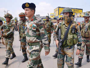 In pic: Army personnel take position during an encounter with armed attackers at the police station in Dinanagar, in Gurdaspur district, Punjab on July 27, 2015.