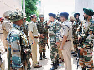 In pic: Army and police personnel during an encounter with militants who attacked a police station at Dinanagar in Gurdaspur district of Punjab on July 27, 2015.