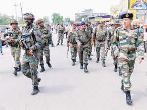In pic: Army personnel take position during an encounter with armed attackers at the police station in Dinanagar town, in Gurdaspur, Punjab on July 27, 2015.