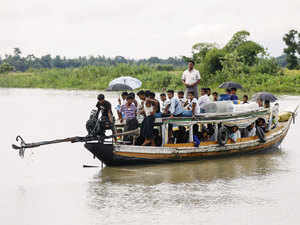File photo: Rohingya Muslims travel on a boat along a river in Buthidaung township on June 7, 2015. Picture taken June 7, 2015.
