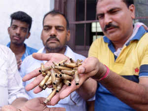 Residents shows bullets shells after a police operation against militants who attacked a police station in Dinanagar town, in the Gurdaspur district of Punjab.