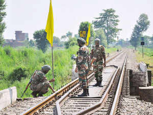 In pic: Army personnel inspect the site where armed militants planted bombs in an attempt to blow railway tracks, in Gurdaspur on July 28, 2015.