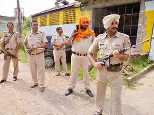 In pic: Army personnel take position during an encounter with armed attackers at the police station in Dinanagar town, Gurdaspur district, Punjab on July 27, 2015