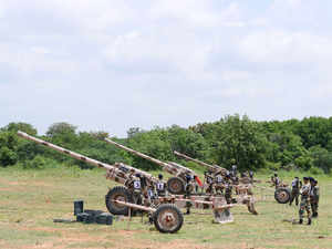 Indian army personnel demonstrate 130 mm Russian field guns during a visit to the '10 Medium Regiment' in Secunderabad on July 25, 2015.