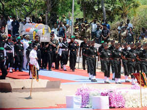 (In pic) Soldiers carry a casket bearing the body of former Indian President APJ Abdul Kalam during his funeral ceremony at The Pei Karumbu Ground in Rameswaram.