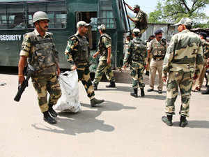 In pic: Paramilitary soldiers carry bags of injured soldiers after a gunbattle with suspected rebels on the J&K highway at Narsoo Nallah, near Udhampur, on Aug. 5, 2015.