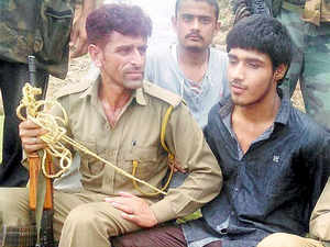 Police with suspected Pakistani terrorist Kasim Khan after an attack on BSF convoy at Jammu-Srinagar national highway at Udhampur district.