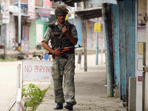 File photo: Army Jawans patrol deserted streets of Kokrajhar as Bodo groups burst out in protest following the arrest of local MLA Pradeep brambha on August 23, 2012.