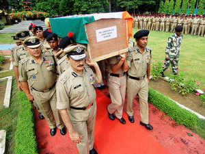 In pic: BSF officers carry the coffins of the soldiers who were killed in militant attack in Udhampur, during the wreath laying ceremony in Jammu on August 6, 2015.