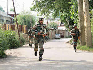 In pic: Army jawans in action during an encounter with militants at Astan-Mohalla Kakapora in Pulwama district of South Kashmir, on August 6, 2015.