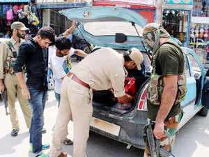 In pic: Special Operation Group (SOG) of Jammu and Kashmir Police Personnel checking a vehicle during a serach operation for militants on August 6, 2015.