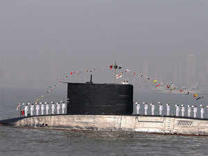 (In Pic) An Indian navy's submarine and a ship are seen during a the Fleet Review (PFR-11) in Mumbai.