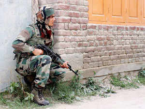In pic: An army soldier in action during the encounter with militants at Kakapora, in Pulwama district of South Kashmir on August 6, 2015.