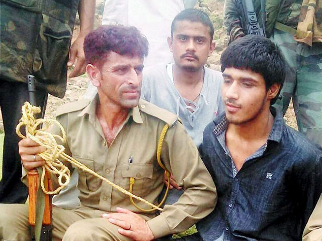 In pic: Police with apprehended suspected Pakistan terrorist after an attack on BSF convoy at Jammu-Srinagar national highway at Udhampur district of J&K.