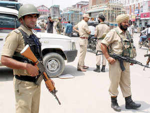 Two brothers of a slain LeT commander were today detained by police when they were roaming around the venue of Independence Day celebrations.