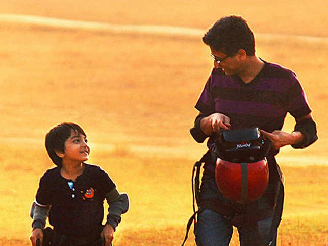Travel enthusiast and founder ofTolexo.com,BrijeshAgrawal para- sailing with nephew Adi in Panchmarhi