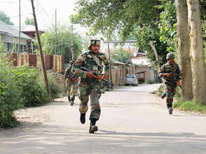 In pic: Army jawans in action during an encounter with militants at Astan-Mohalla Kakapora in Pulwama district of South Kashmir, on August 11, 2015.