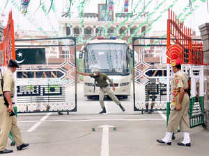 BSF jawans and Pak Rangers opening gates to enable Lahor-Delhi Bus to enter India on Independence day at Attari-Wagah border.