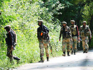 In pic: Army takes position during a gunfight with militants in Pulwama district in South Kashmir on Tuesday 11 August 2015.