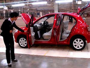 A visitor inspects a car at Renault-Nissan'sOragadam factory.