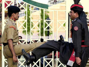 File photo: An Indian paramilitary trooper and Pakistani counterpart parade in opposite directions during the routine flag lowering ceremony at Wagah border on May 3, 2003.