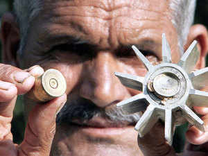 (Representative image) A man showing remains of a mortar shell fired by the Pakistani rangers at Pargwal village in Akhnoor, Jammu.