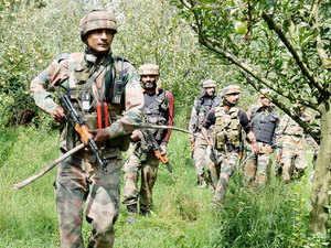 In pic: Army personnel during an encounter with militants at Ratnipora in Pulwama district of South Kashmir on August 11, 2015.