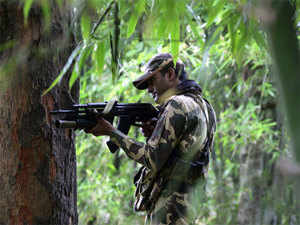(In pic) A member of the Indian Central Reserve Police Force (CRPF) patrols through a village in the Tisro area of the Giridih district in the eastern Indian state of Jharkhand.