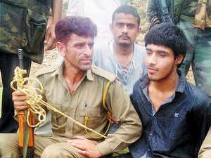 In pic: Police with Pakistani terrorist Naveed after an attack on BSF convoy at Jammu-Srinagar national highway at Udhampur district of J&K on August 5, 2015.